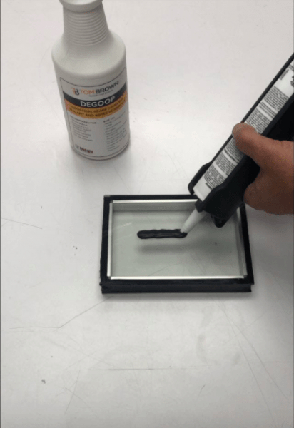 Applying Black Structural Silicone Sealant Pittsburgh | Tom Brown, Inc.